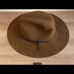 Fedora hat with felted wool and slight structure.